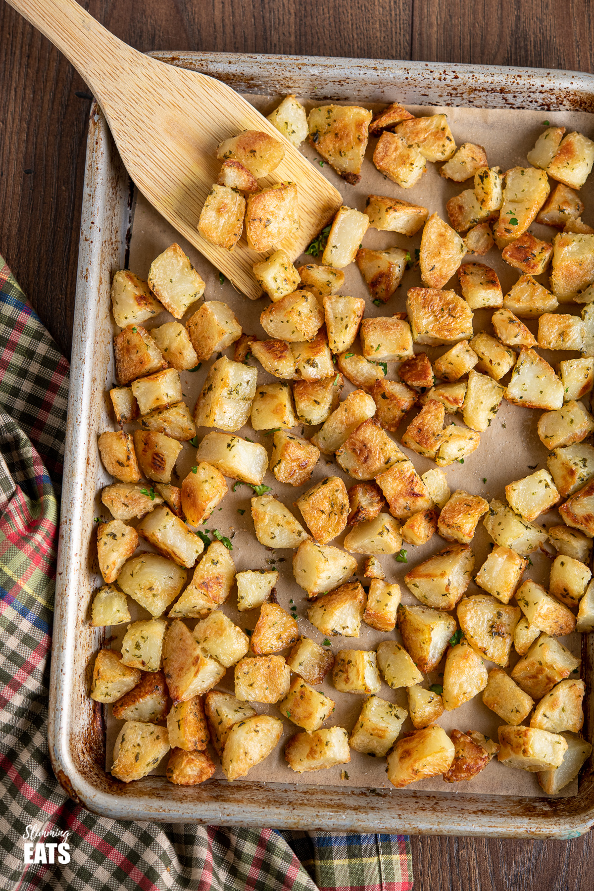 Garlic and Herb Roasted Potatoes on a parchment lined baking tray