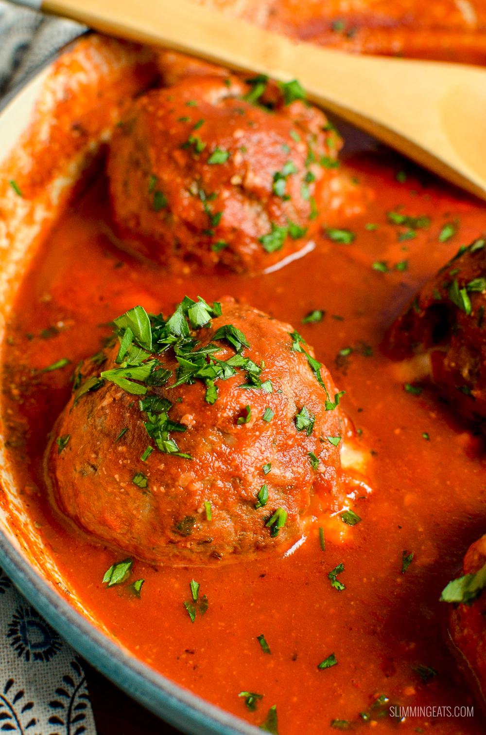 close up of mega stuffed meatballs in tomato sauce