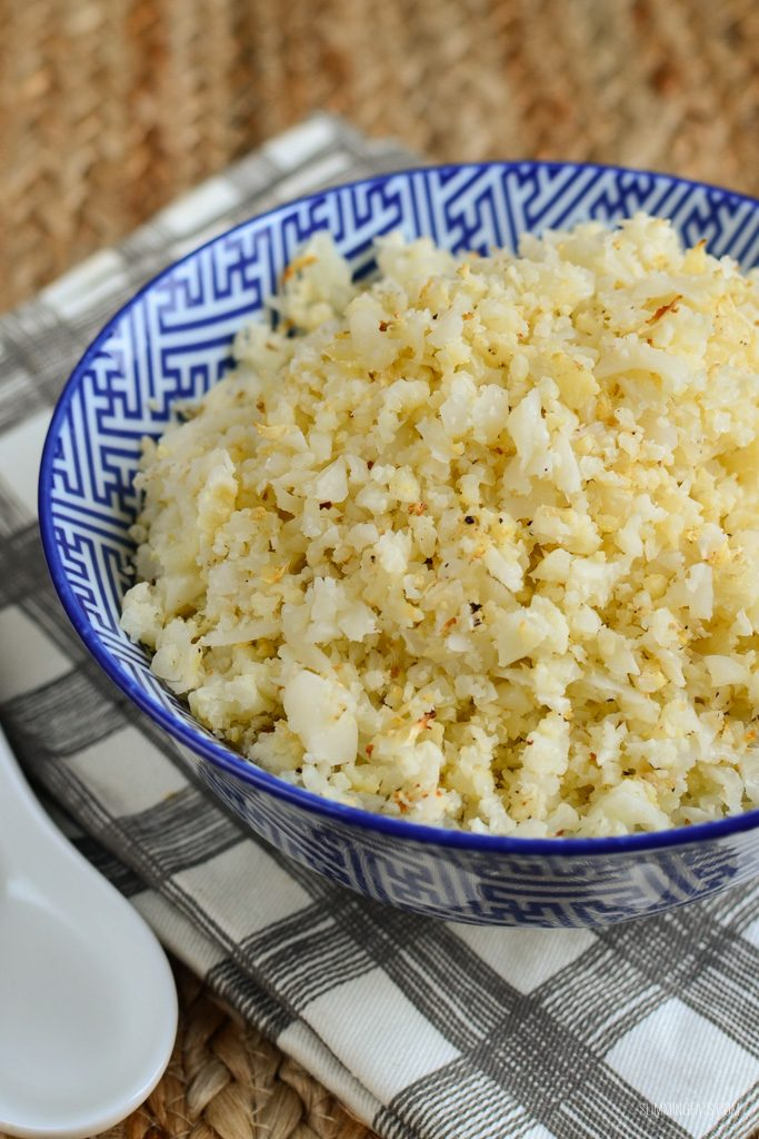 roasted cauliflower rice in a blue and white bowl