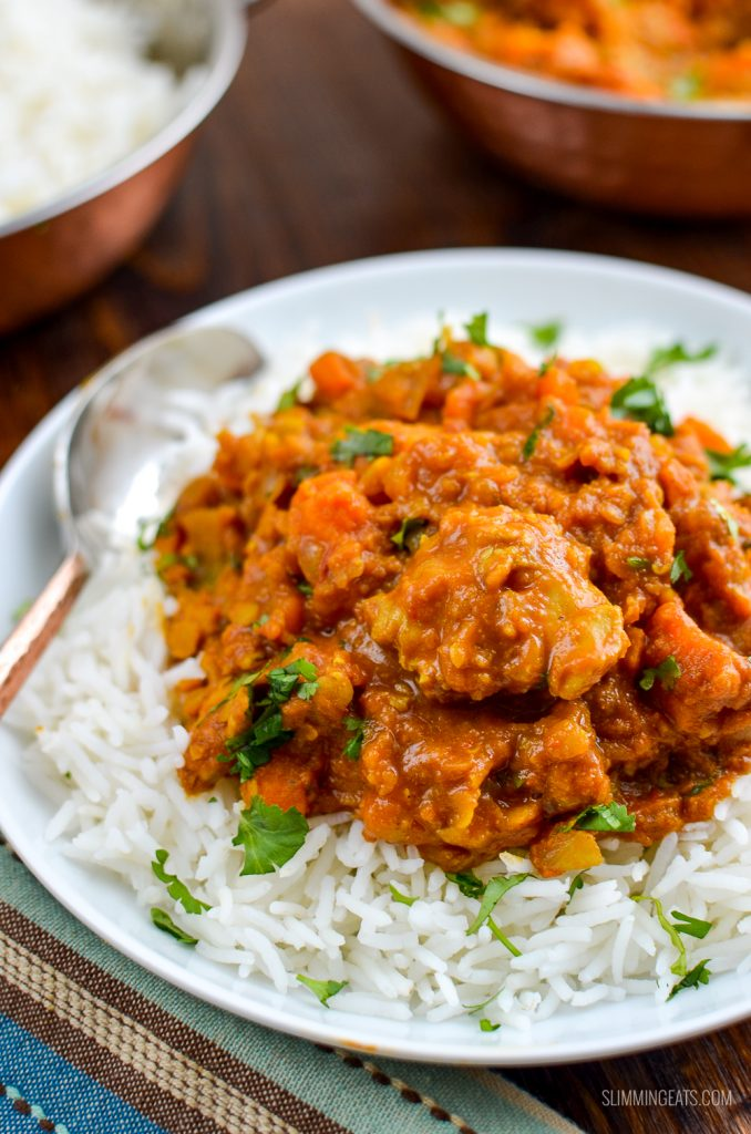 chicken, sweet potato and lentil curry in white bowl with rice