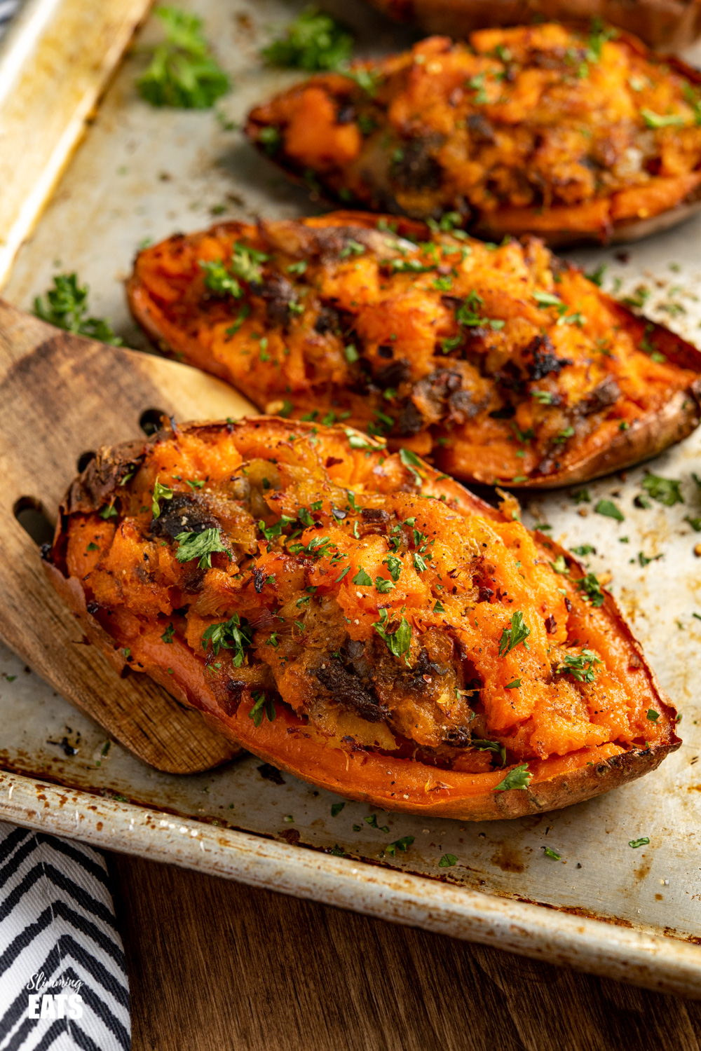 double baked sweet potatoes stuffed with smoked mackerel on a baking tray