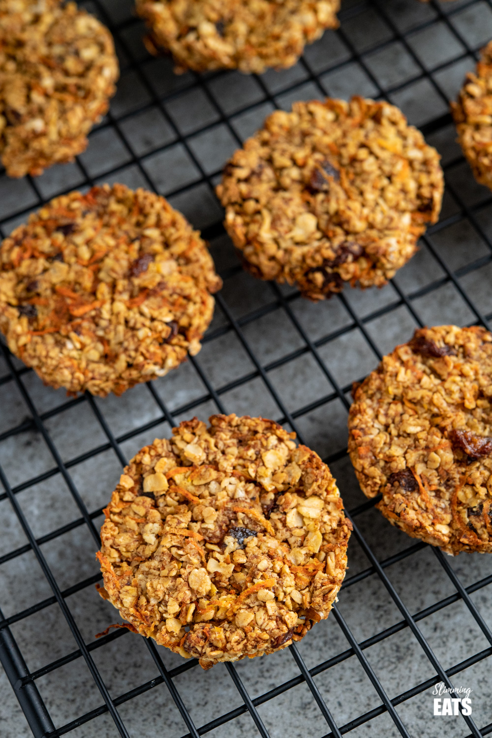 close up of carrot cake flapjack cookies on black metal rack.