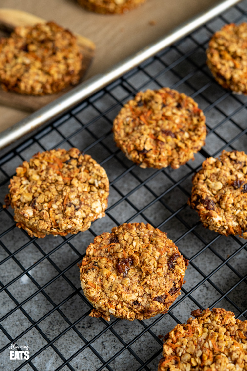 carrot cake flapjack cookies on black metal rack.