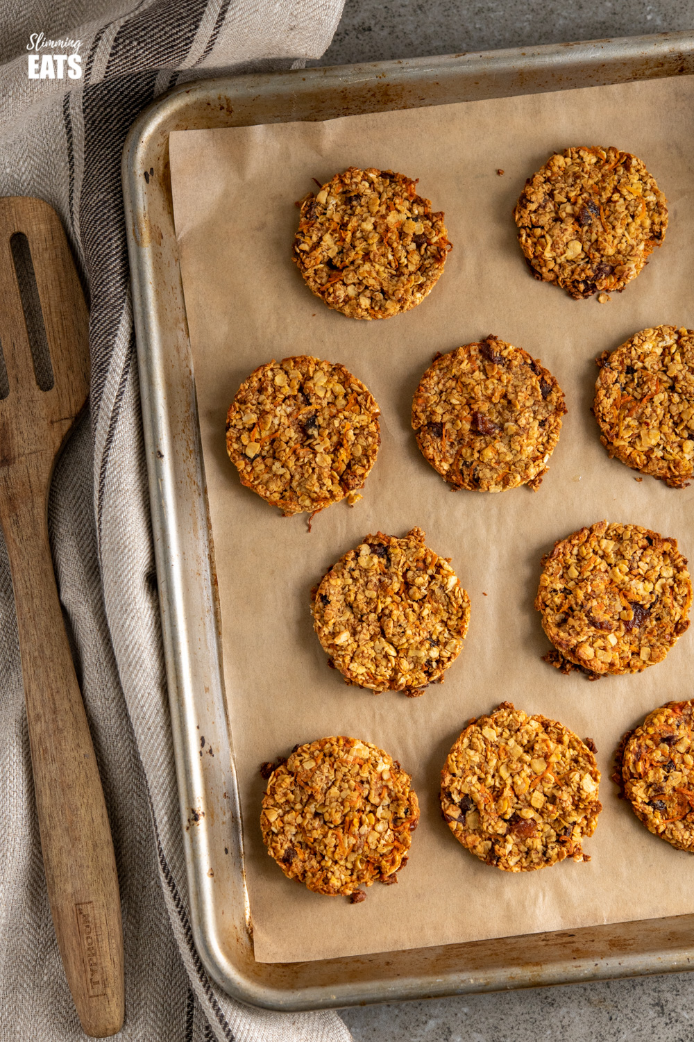 carrot cake flapjack cookies fresh out of the oven on a parchment lined baking tray