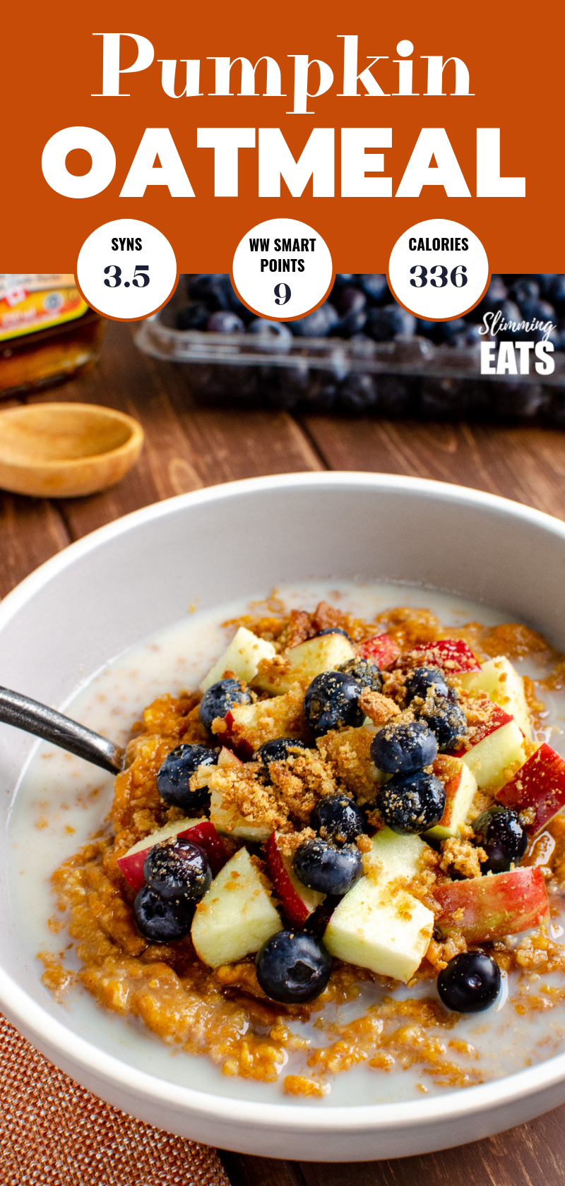 pumpkin oatmeal in grey bowl with blueberries, apple and crumbled biscuit pin image.