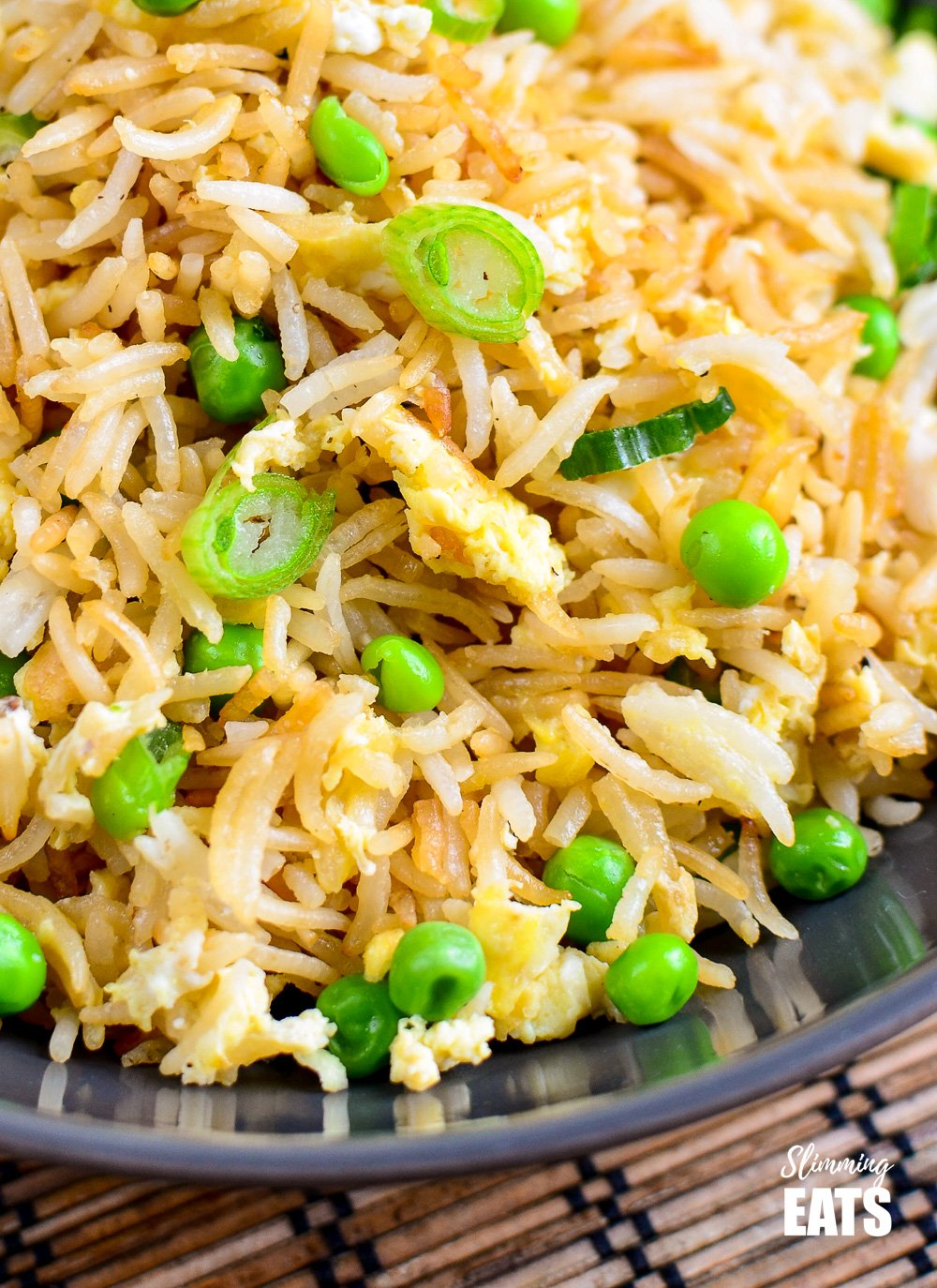 close up of egg fried rice in a grey bowl