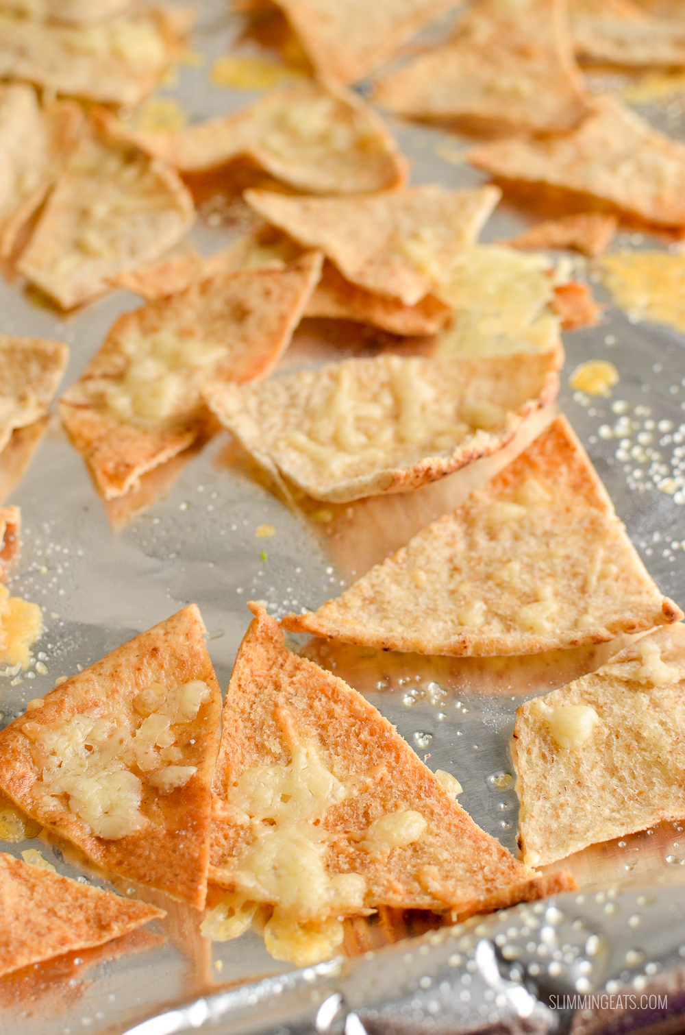 close up of cheddar pita chips on a baking tray