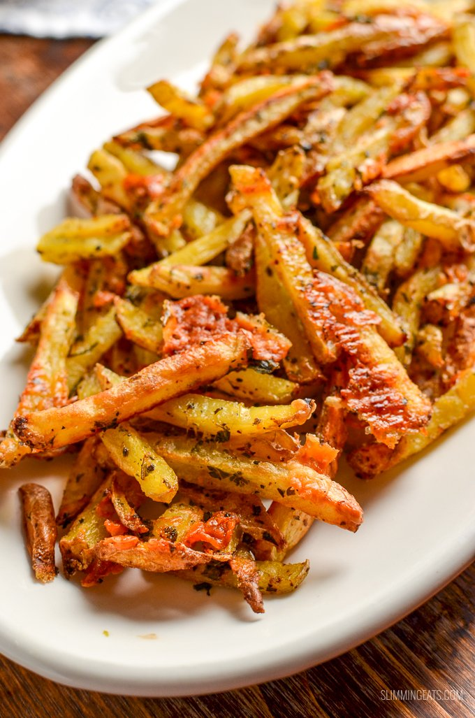 close up of garlic parmesan fries on white plate