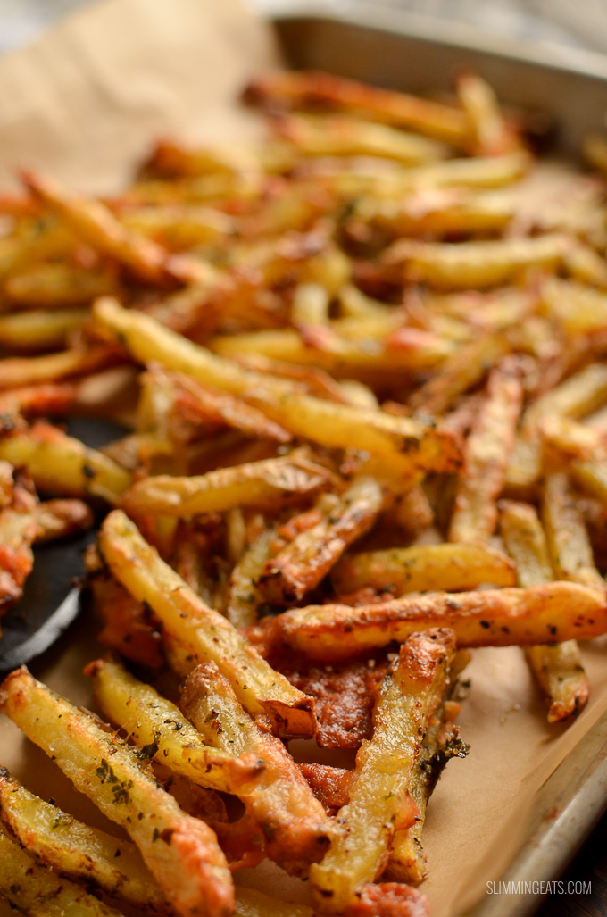 cheesy garlic parmesan fries on tray lined with parchment