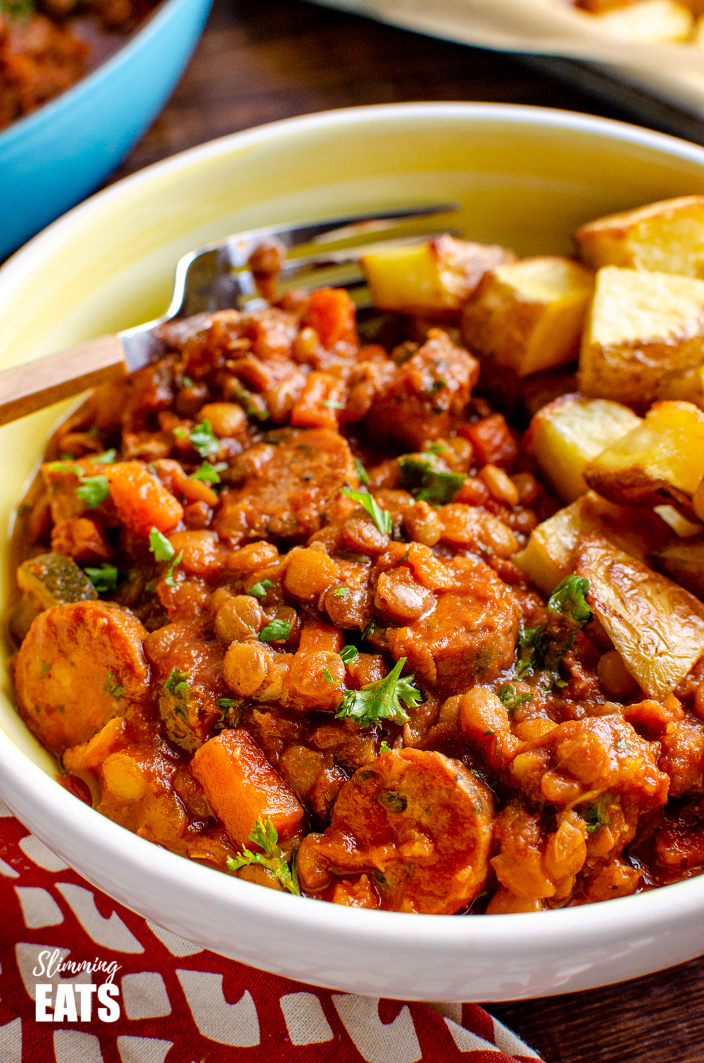 close up of. One Pot Sausage and Lentil Casserole in yellow and white bowl
