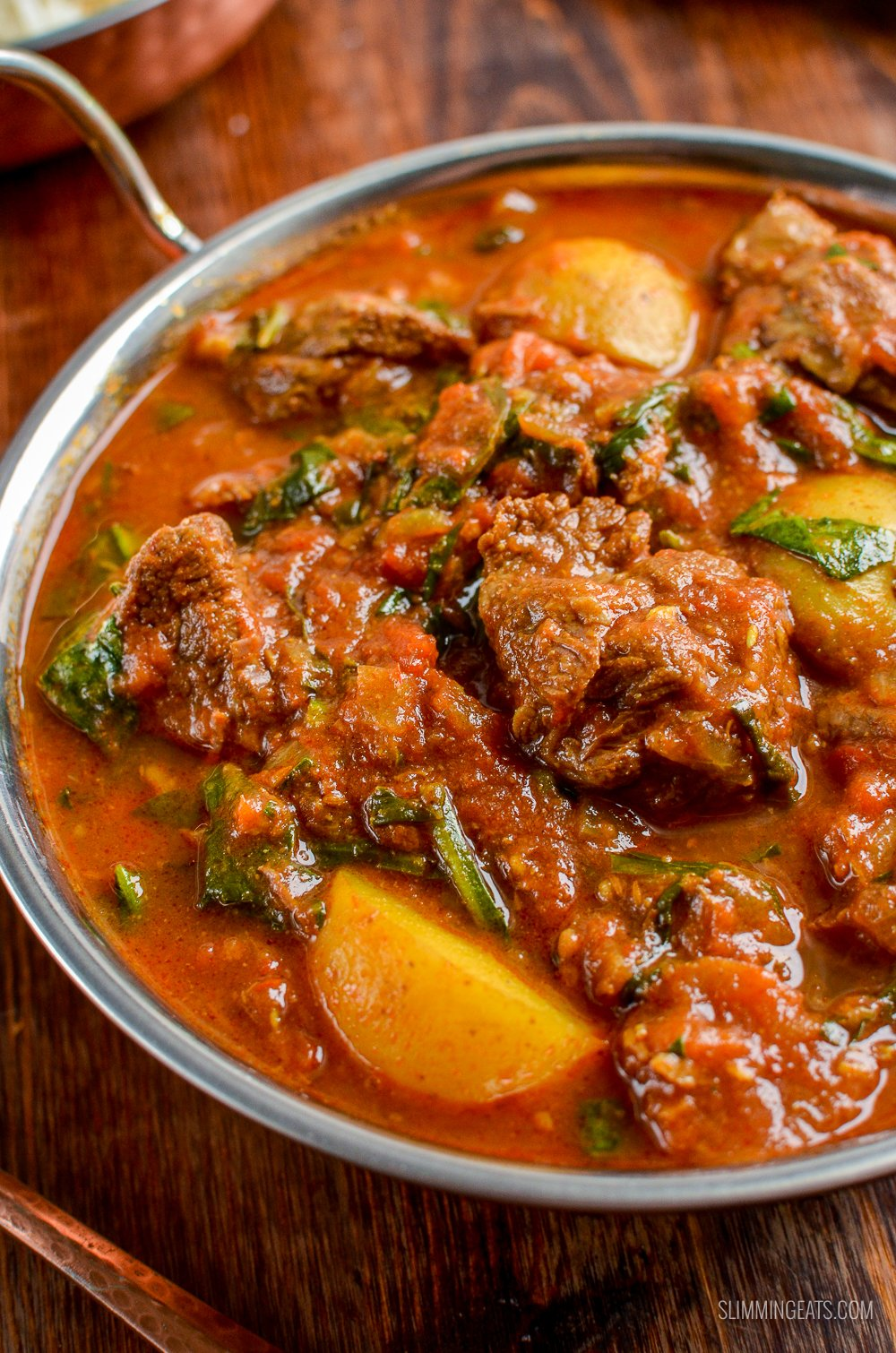 close up of beef and potato curry in dish