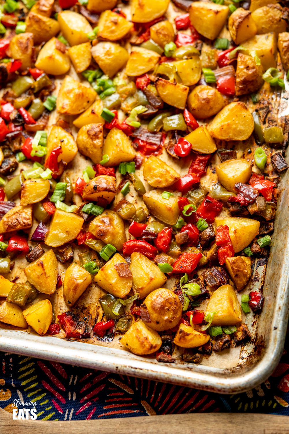 syn free breakfast potatoes on tray with patterned towel