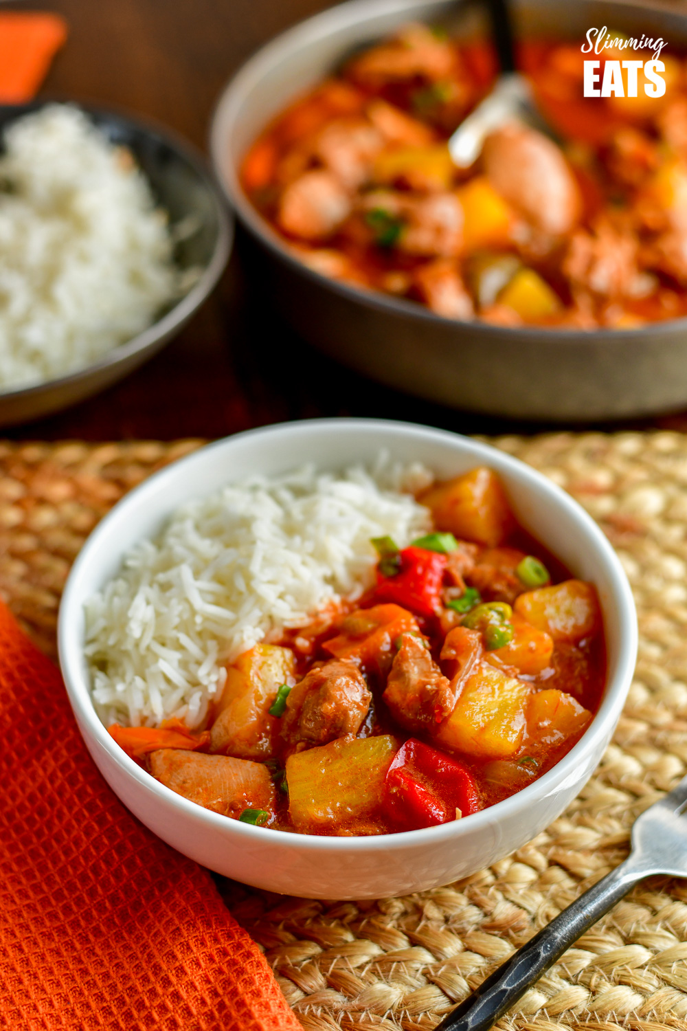 instant pot sweet and sour chicken in white bowl with white rice