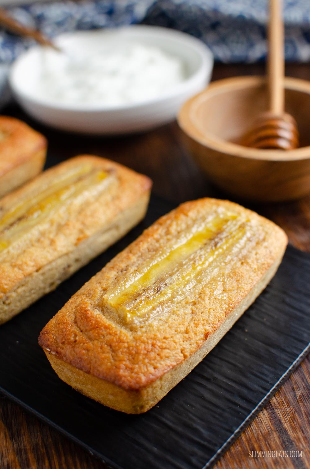 low syn mini banana raisin loaf on black tray with honey and yoghurt