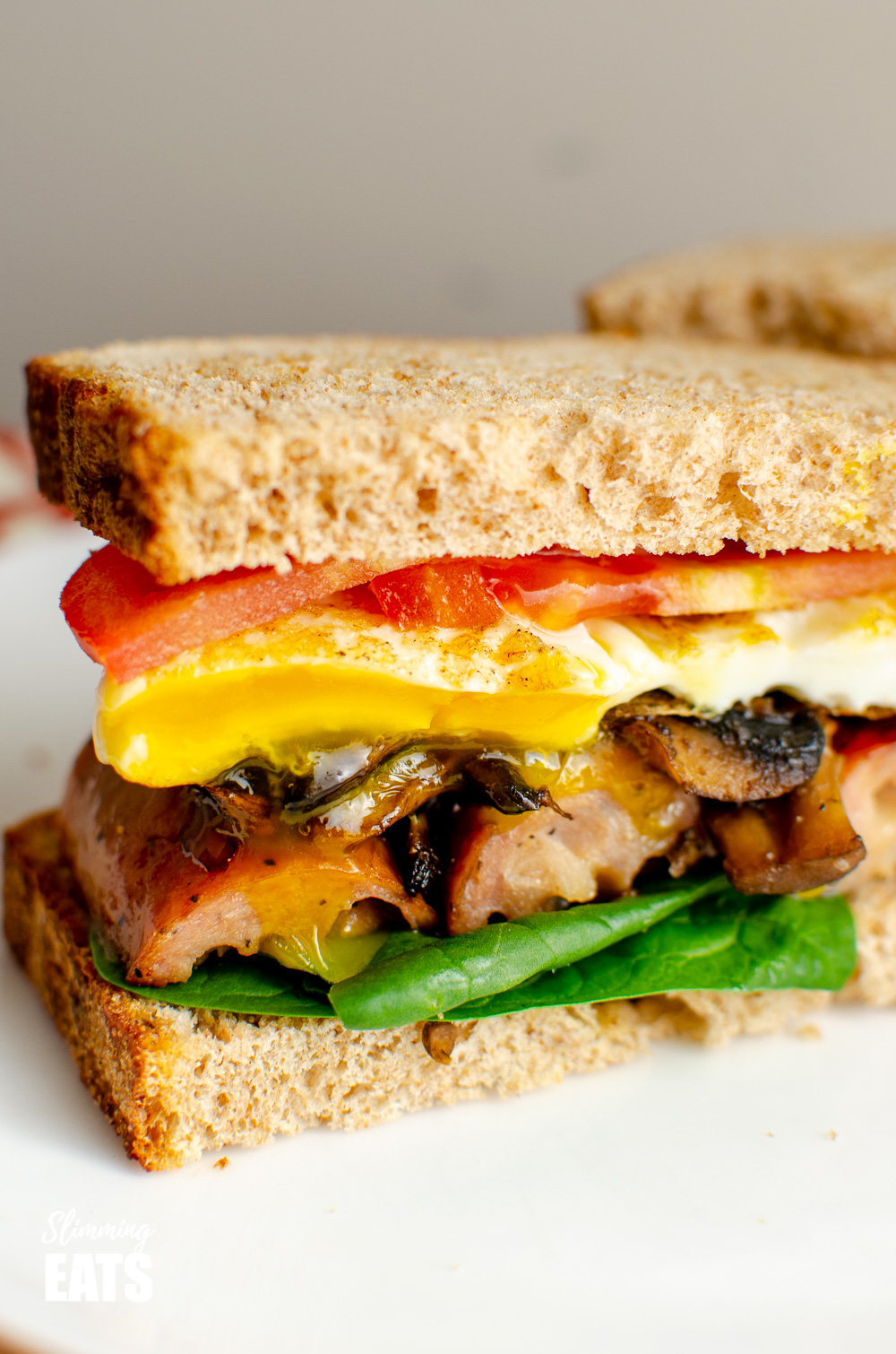 close up of The Ultimate Breakfast Sandwich on white plate