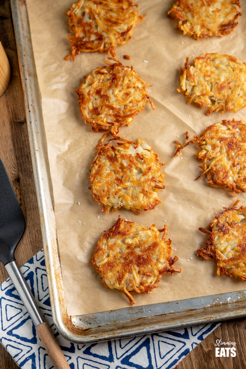 eight hash browns on a parchment lined baking tray
