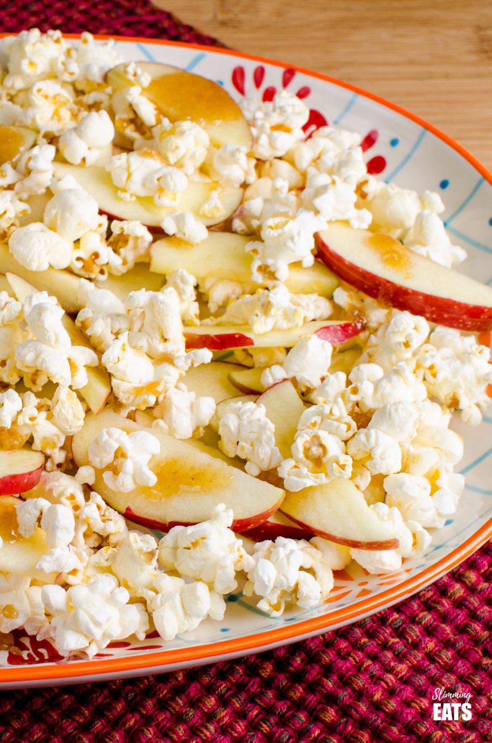 close up of caramel apple popcorn nachos on patterned plate