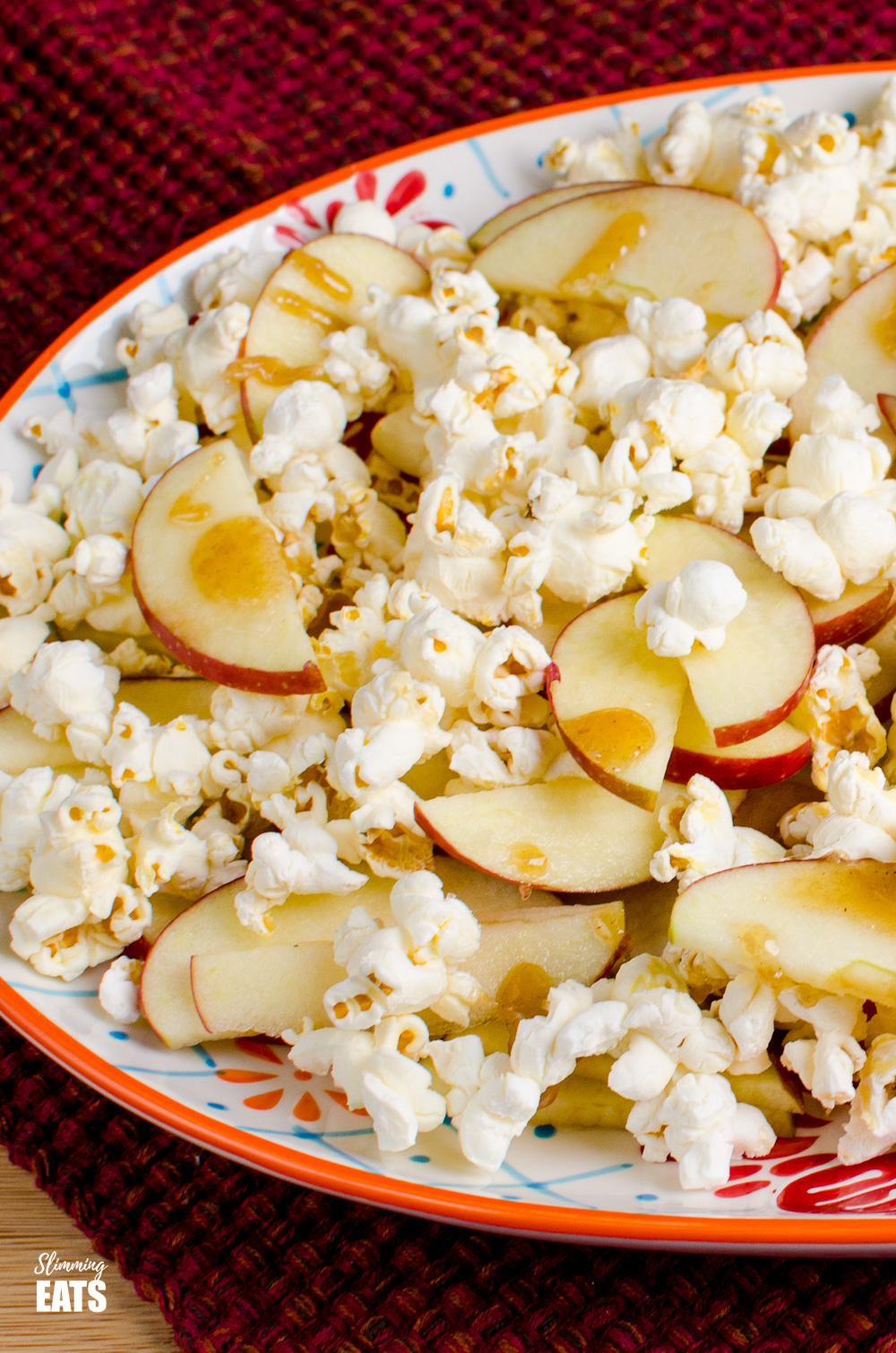 close up of caramel apple popcorn nachos on oval patterned plate