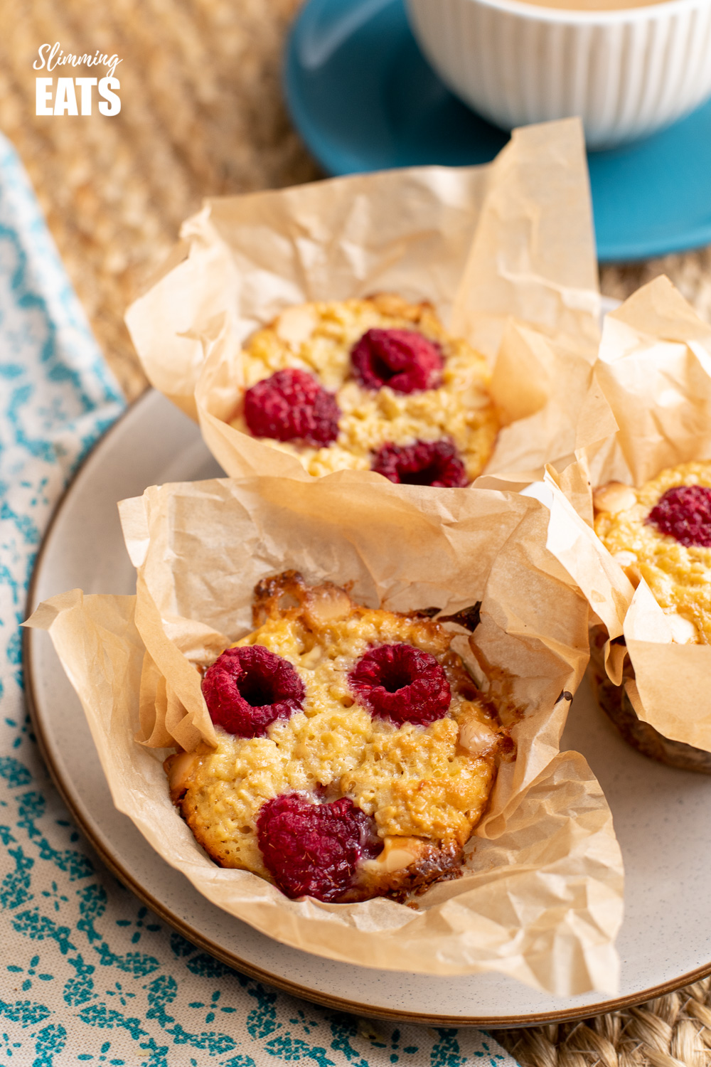 raspberry and white chocolate baked oatmeal in parchment paper on plate