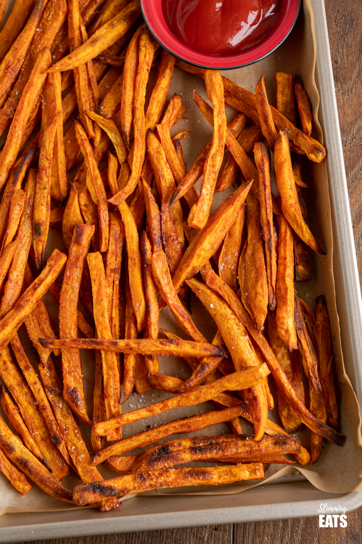 close up of sweet potato fries on baking tray