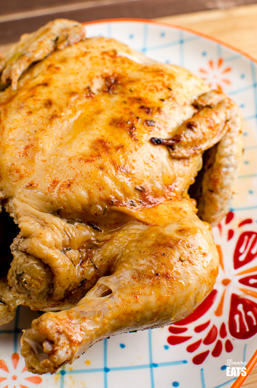 pressure cooked whole chicken on a patterned oval plate