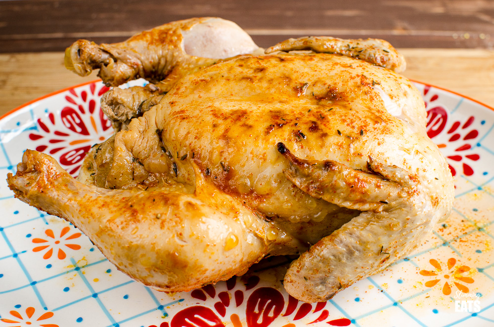 cooked whole chicken from instant pot on oval patterned plate