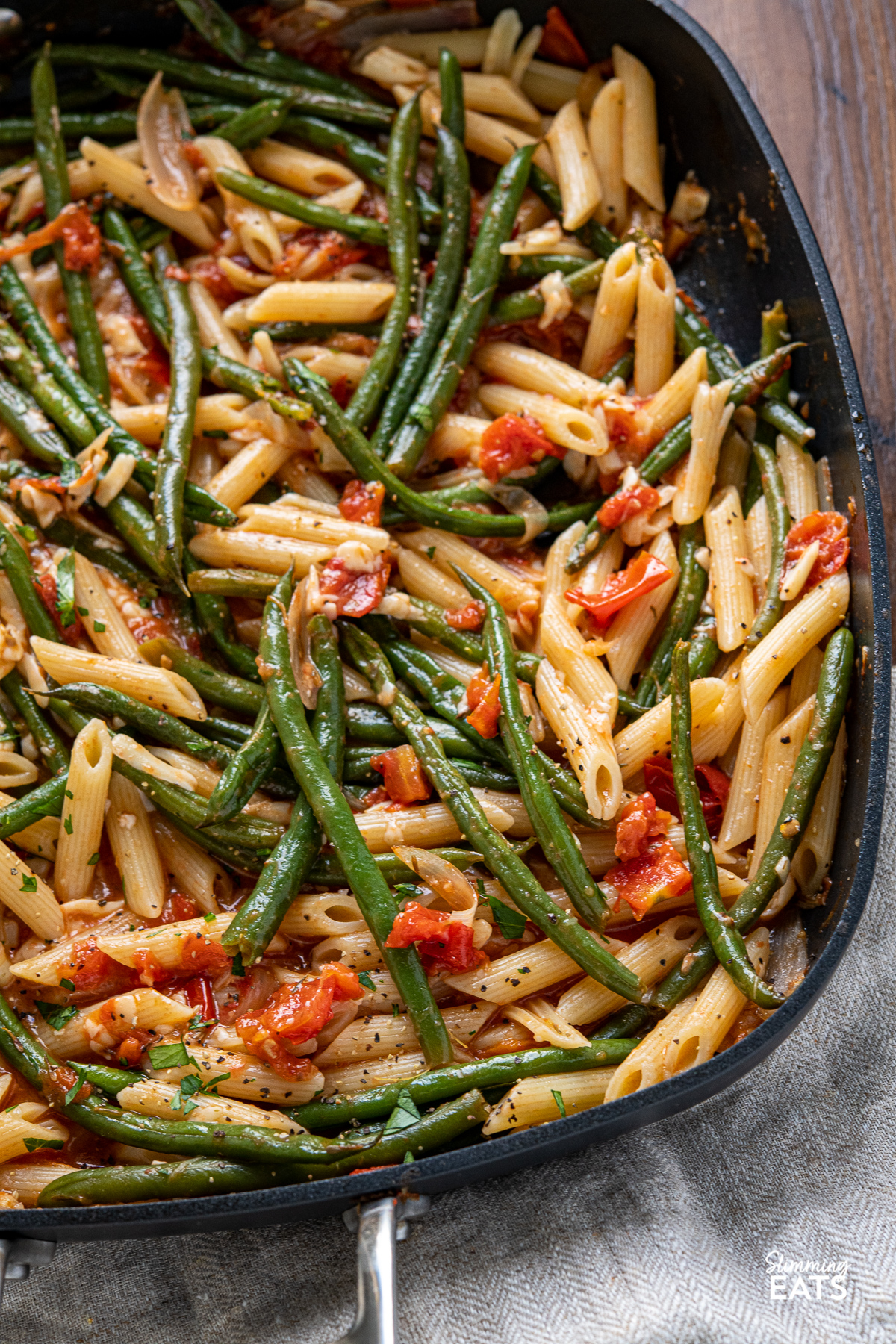 close up of Roasted Green Bean and Tomato Pasta in all clad square skillet