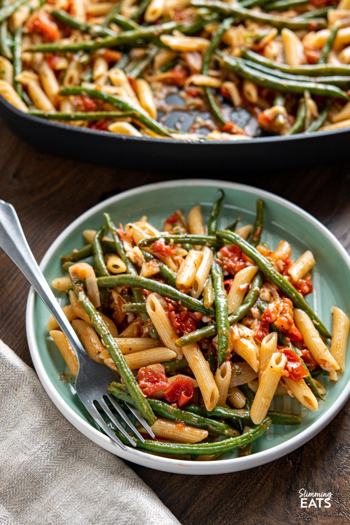 serving of Roasted Green Bean and Tomato Pasta on turquoise plate