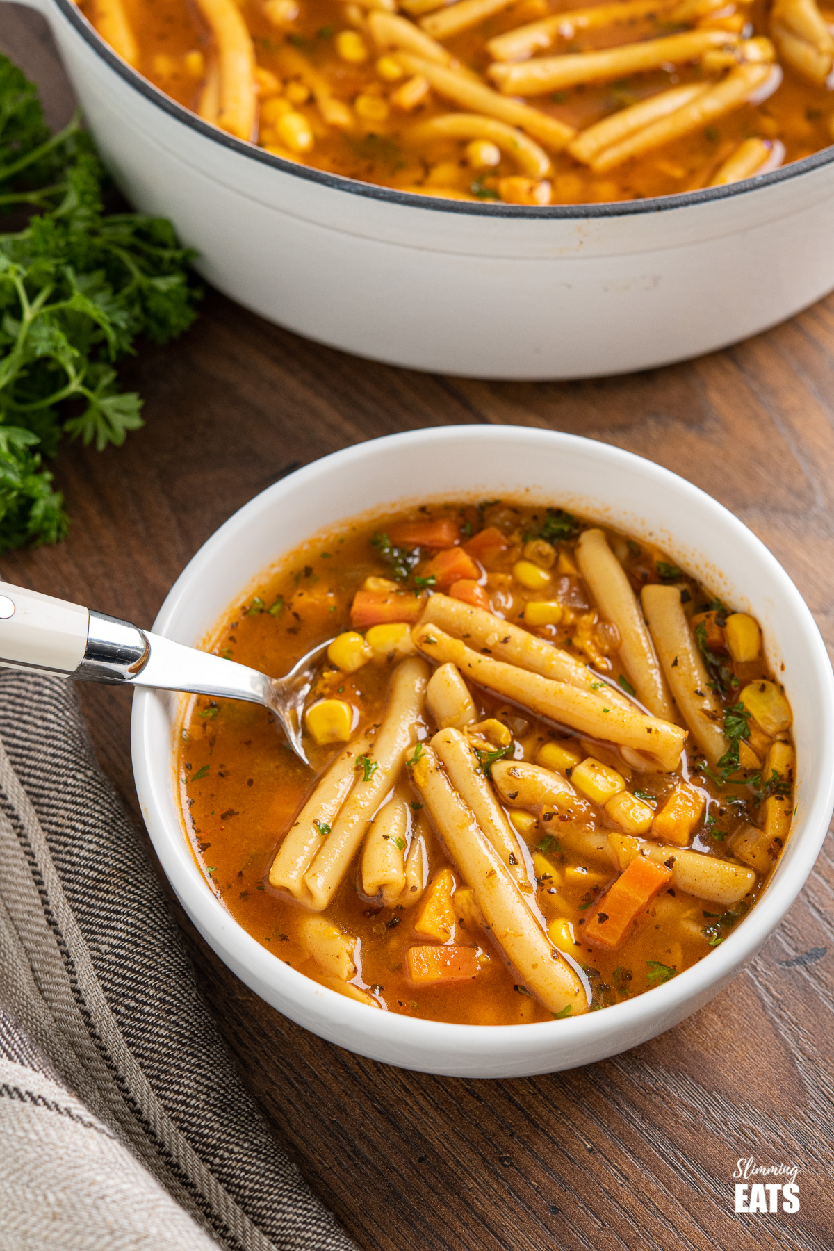 instant pot vegetable noodle soup in white bowl