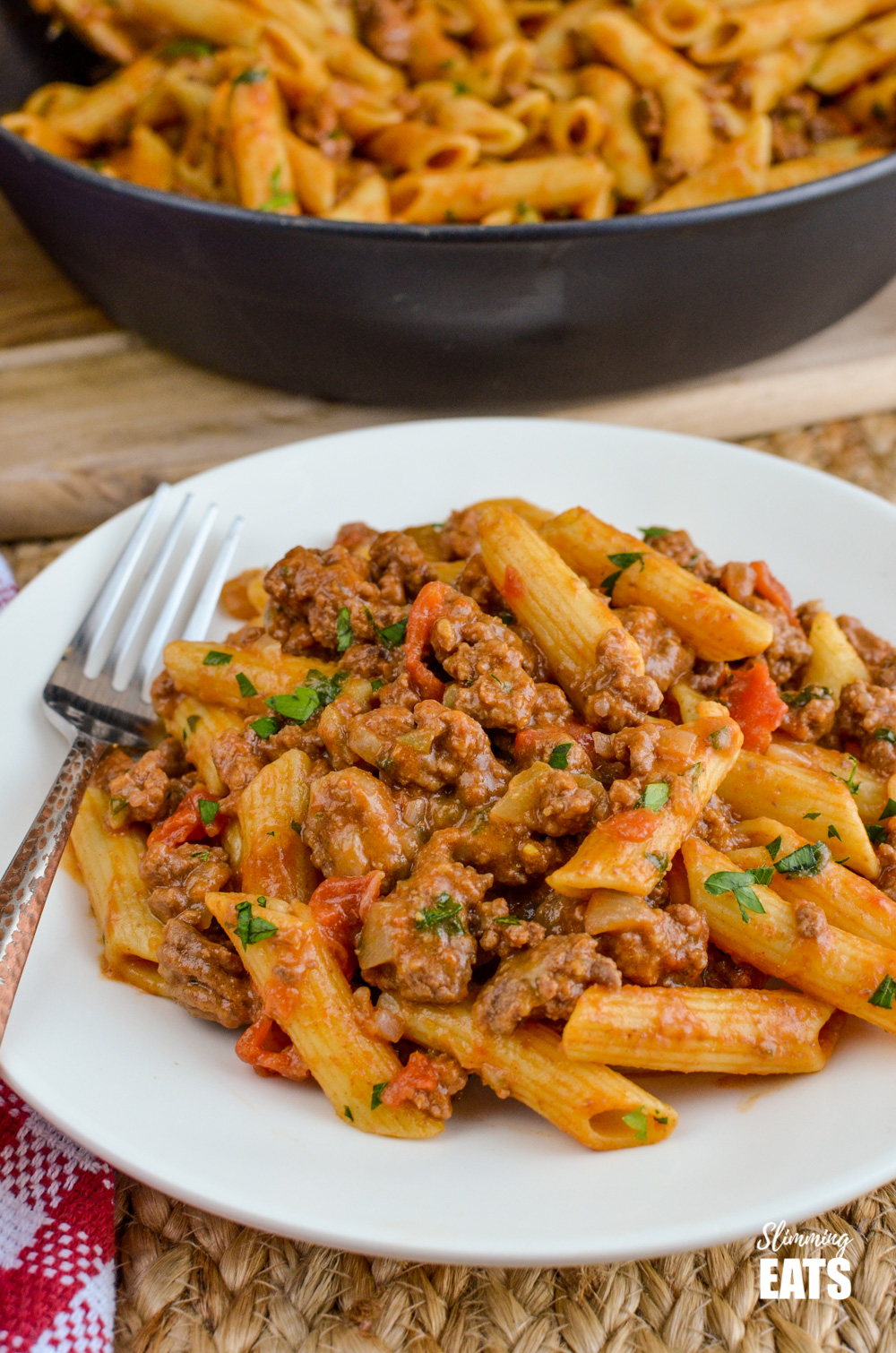 one pot cheeseburger pasta on white plate with fork