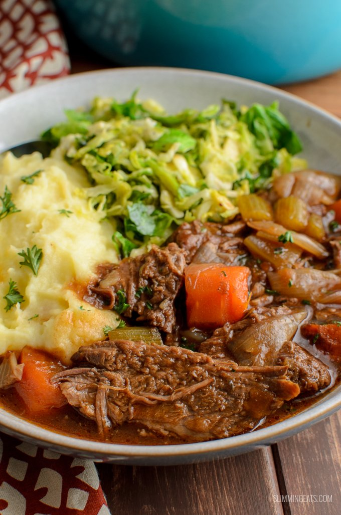 Melt in your mouth Low Syn Slow Cooker Guinness Beef Brisket - a delicious rich hearty dish that is pure comfort in a bowl. Dairy Free, Slimming World and Weight Watchers friendly | www.slimmingeats.com
