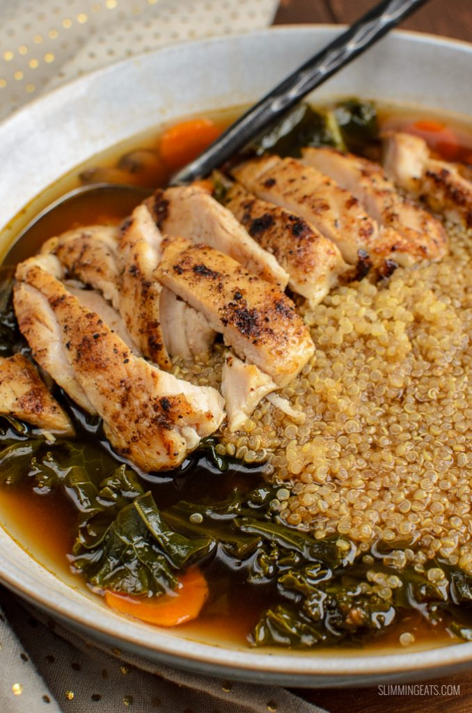 chicken, quinoa, kale bowl with spoon