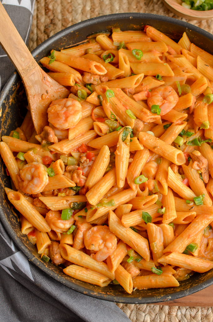New Orleans Cajun Pasta in a deep black frying pan with wooden spoon