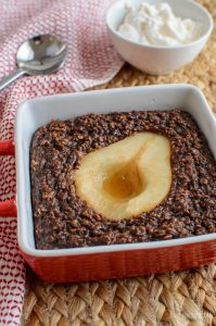 delicous ripe pear in chocolate baked oats