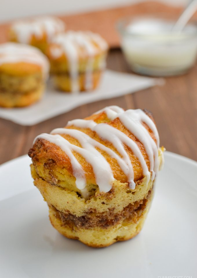 cinnamon roll baked oat muffins on white plate