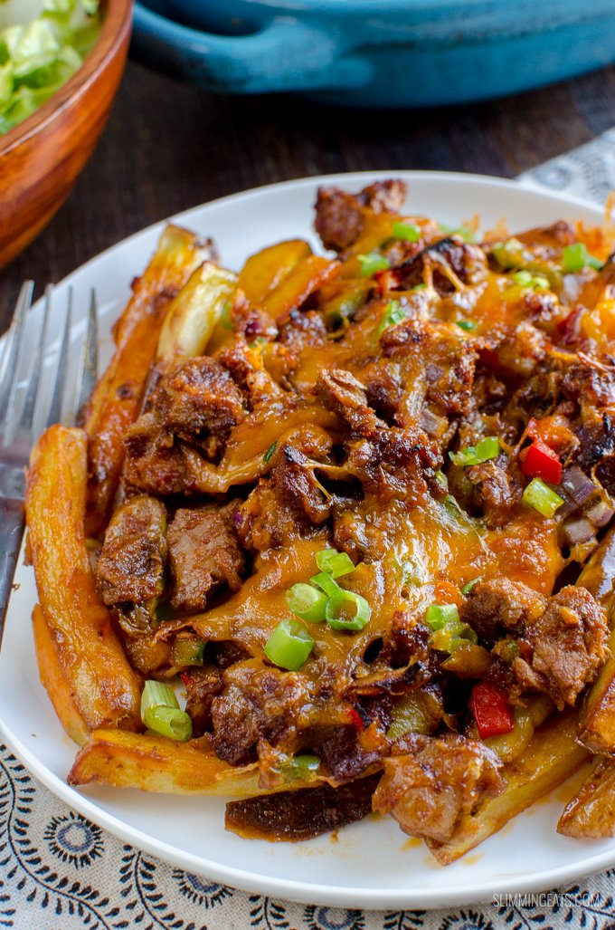 Make the ultimate sharing dish with these Amazing Pulled Pork Loaded Fries - a perfect recipe for leftover Pulled Pork. Gluten Free, Slimming World and Weight Watchers friendly | www.slimmingeats.com
