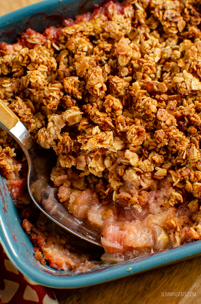 Nothing better than a delicious bowl of Low Syn Cinnamon Oat Rhubarb Crumble - sweet tangy stewed rhubarb topped with a yummy golden topping. gluten free, dairy free, vegetarian, Slimming World and Weight Watchers friendly #slimmingworld #weightwatchers