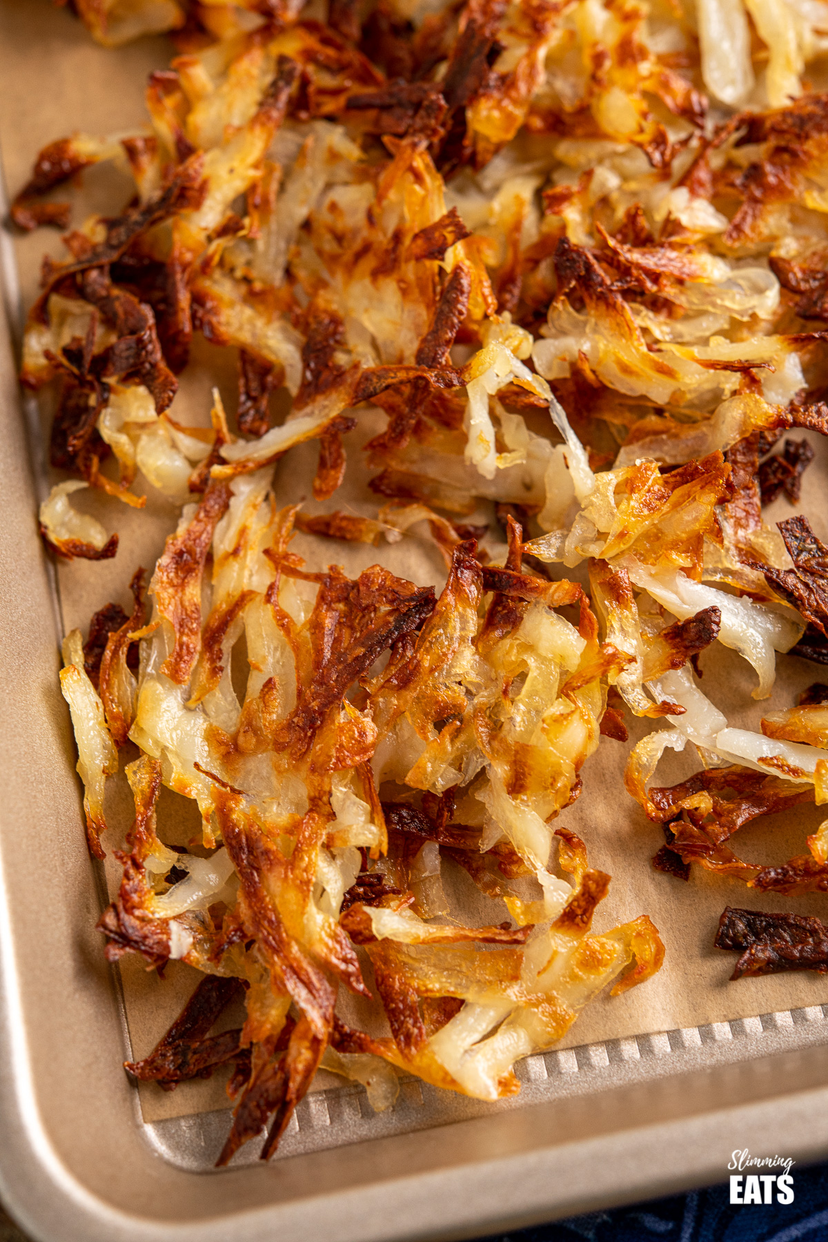 close up of shredded potato hash browns on baking tray