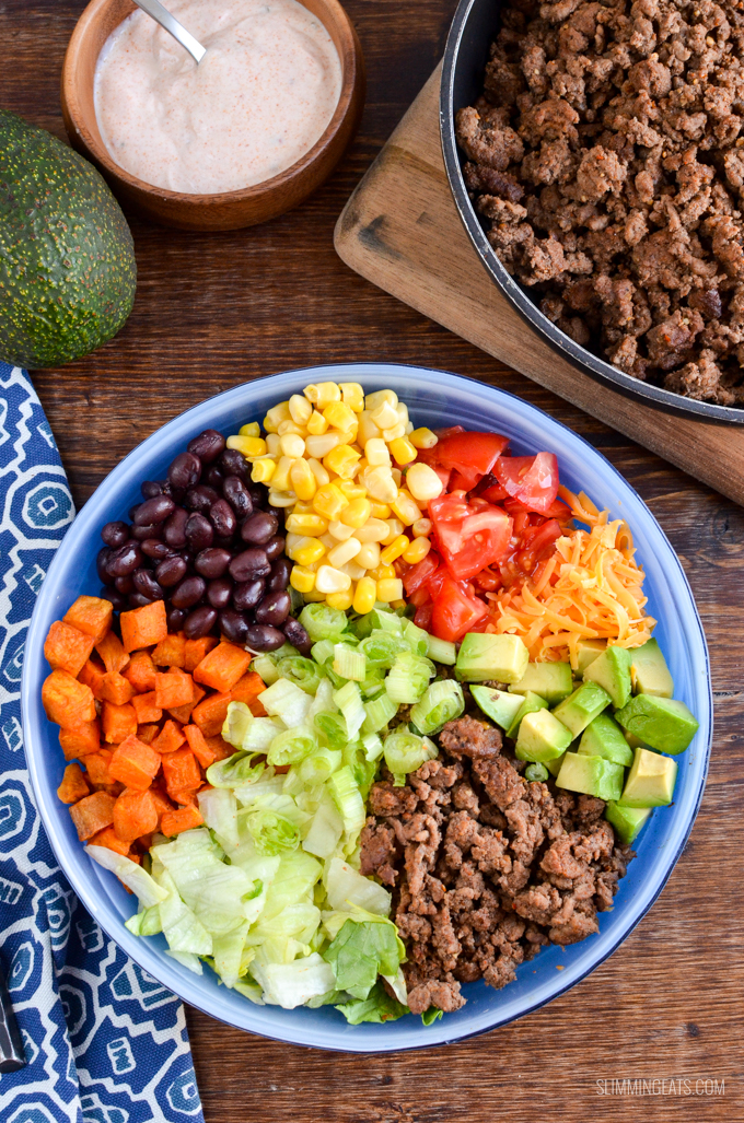 Love Tacos? Dig into this ultimate Low Syn Taco Salad Bowl which is gluten free, Slimming World and Weight Watchers friendly #slimmingworld #weightwatchers #beef #tacosalad