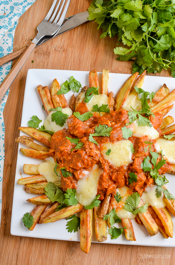 Butter Chicken Poutine!! - The ultimate dish for leftover butter chicken - crispy golden syn free fries, topped with butter chicken and melted cheese make this one of those recipes you will not ever want to end. Gluten Free, Slimming World and Weight Watchers friendly