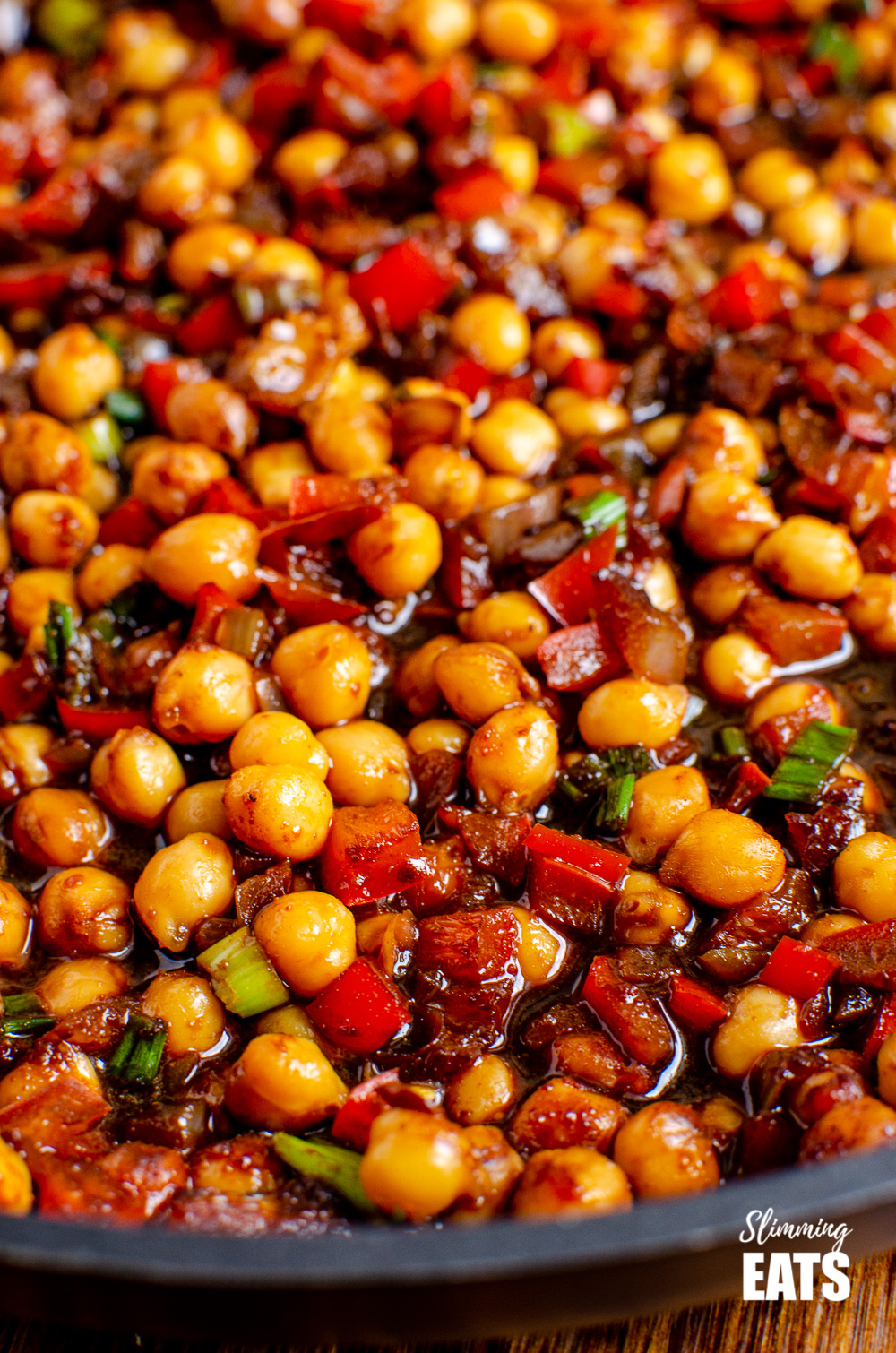 close up of Chinese 5 spice Chickpeas in black frying pan