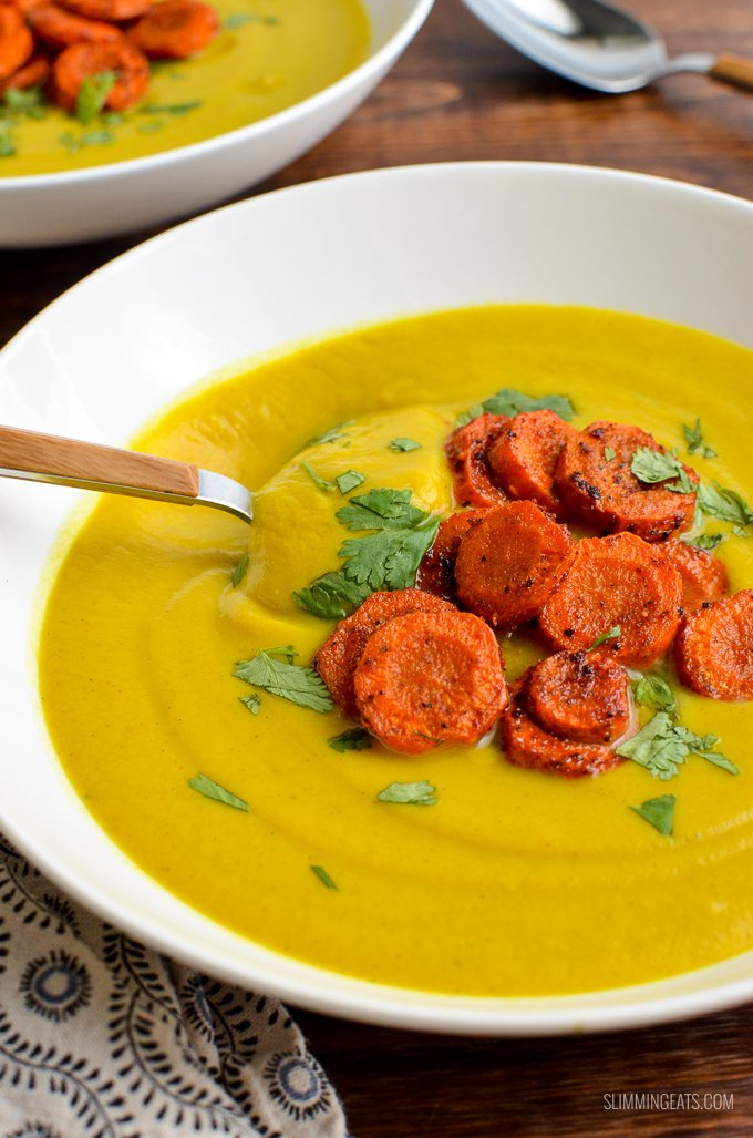 The beautiful vibrant colour of turmeric makes this delicious and healthy Low Syn Golden Cauliflower Soup with Roasted Paprika Carrots | gluten free, dairy free, paleo, Whole30, Slimming World and Weight Watchers friendly