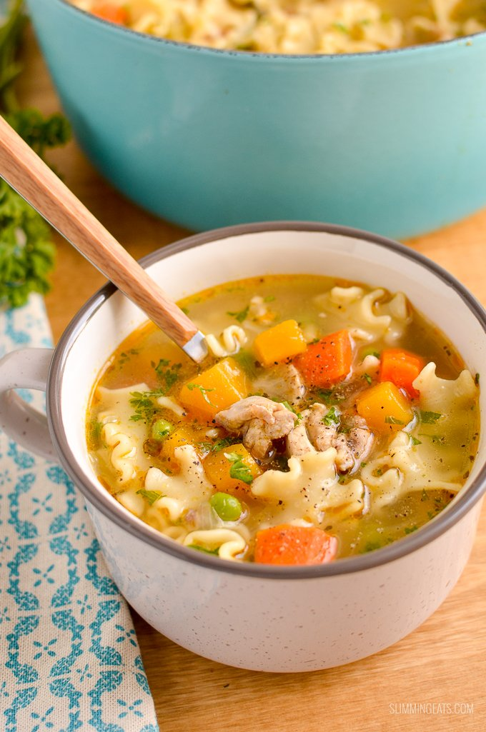Chicken Vegetable Pasta Soup in Soup Mug with spoon