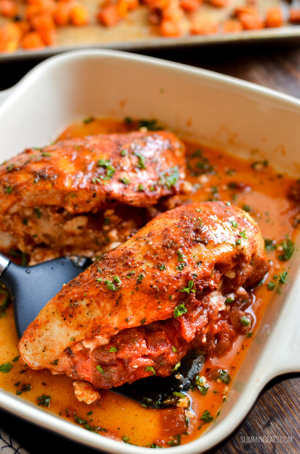 spicy chicken stuffed with feta cheese and salsa in oven proof dish