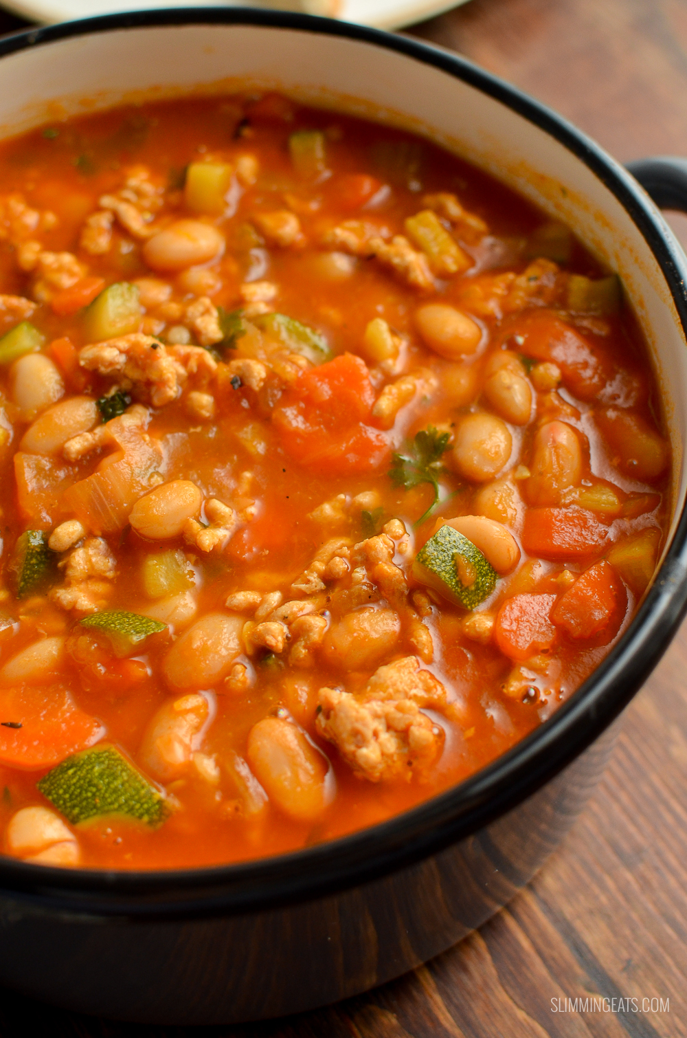 close up of syn free ground turkey vegetable bean soup in grey saucepan