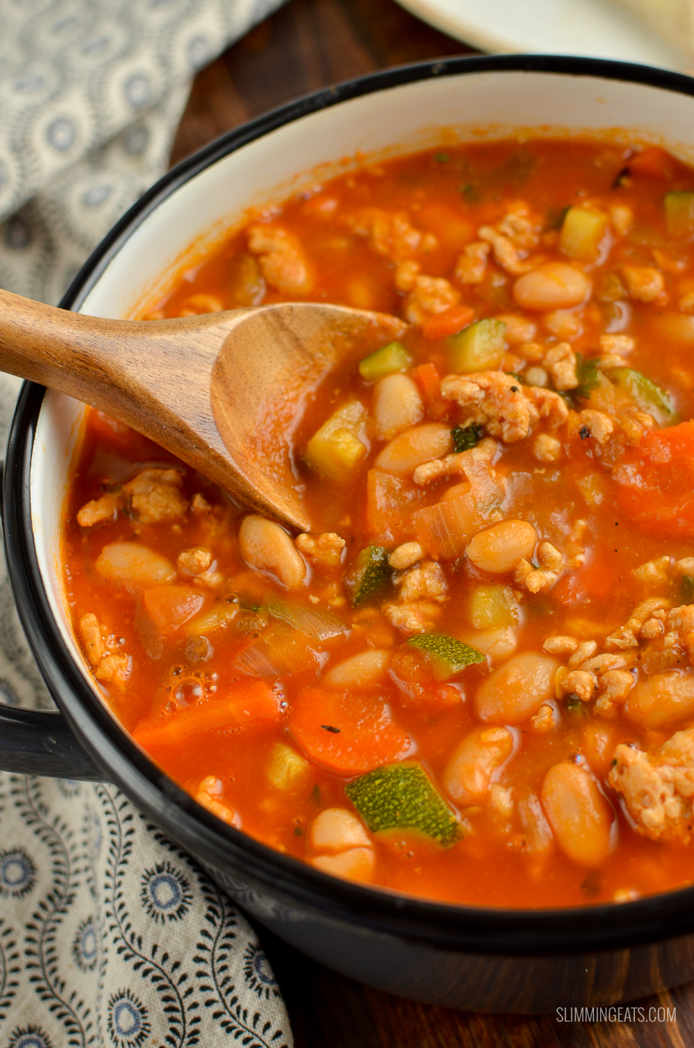 Syn Free ground turkey vegetable bean soup in grey saucepan with wooden spoon
