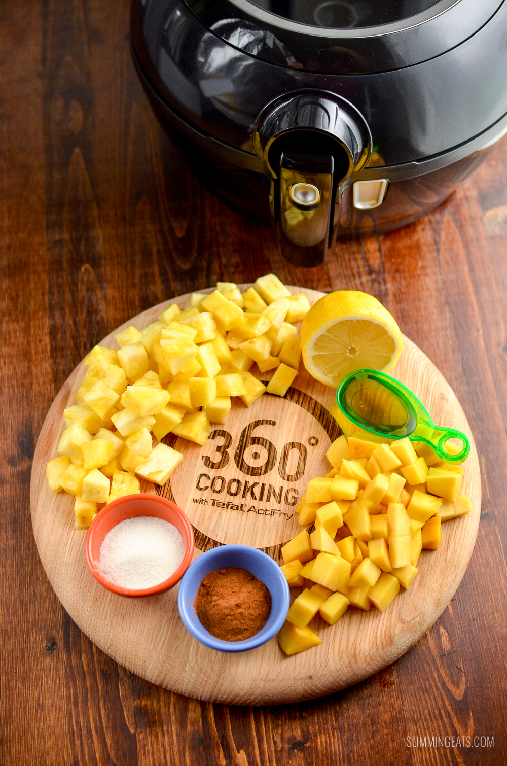 ingredients on wooden board for roast mango and pineapple with Tefal Actifry Genius