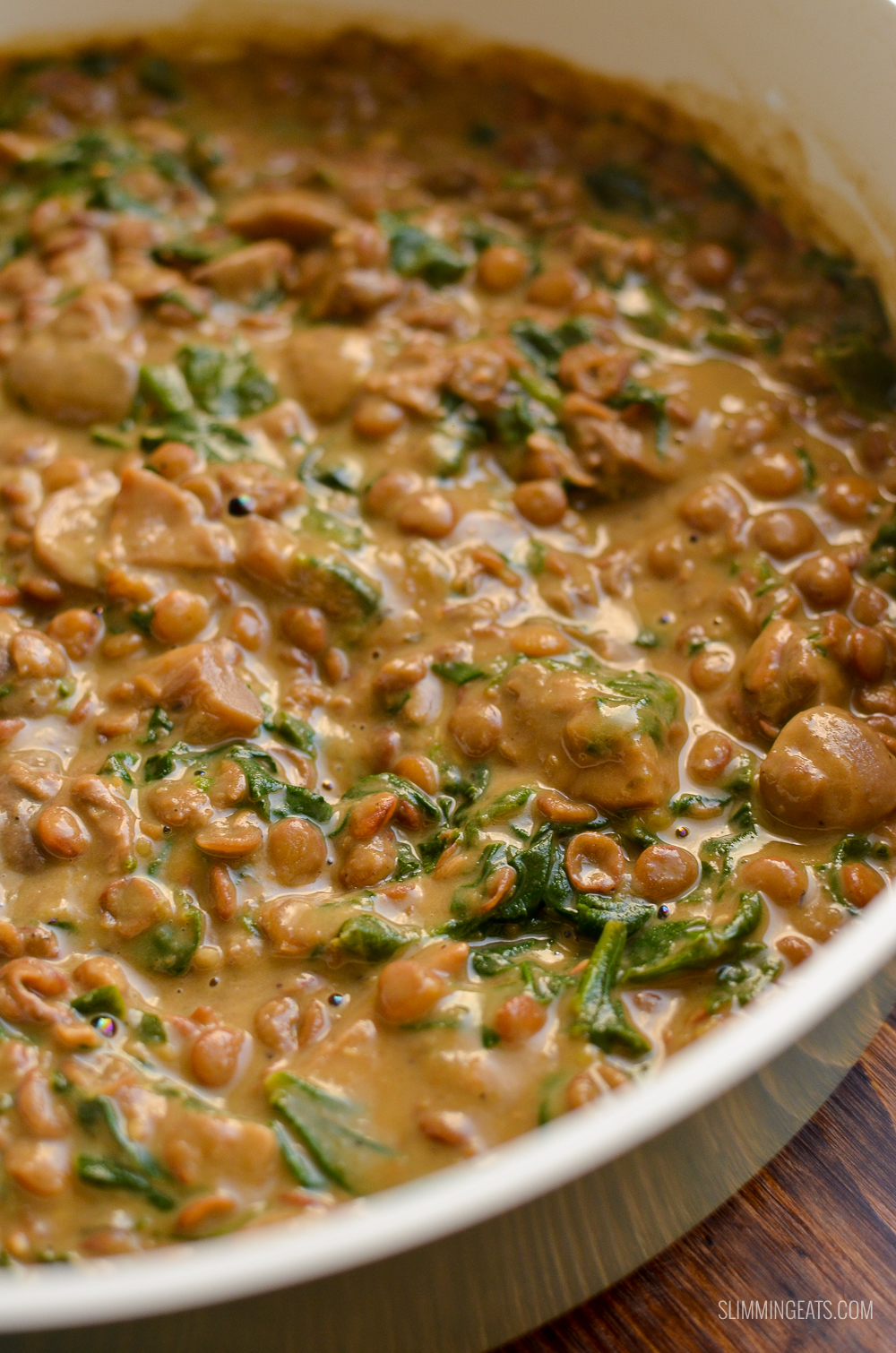 close up of creamy coconut mushroom lentils in pan