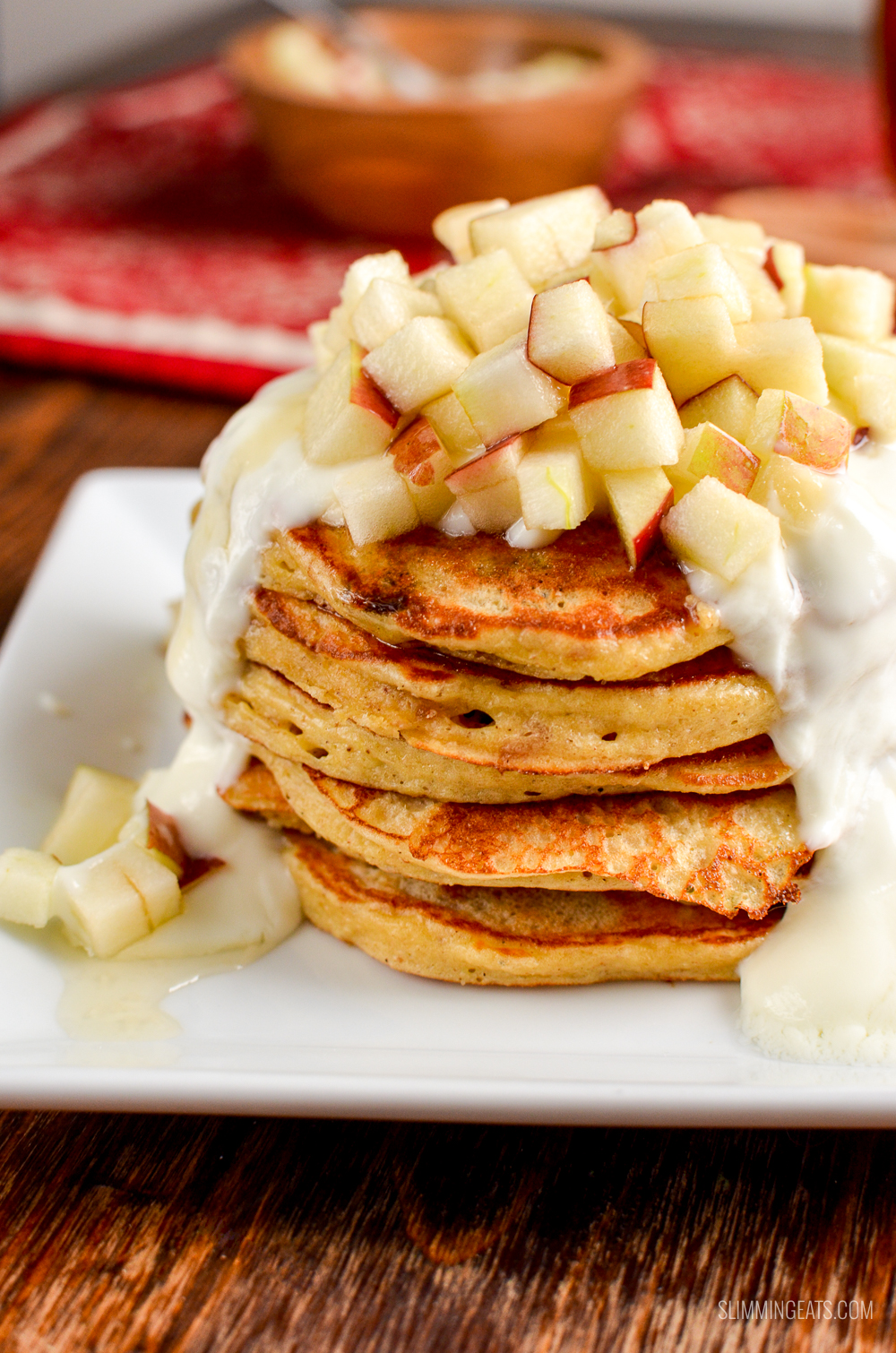close up of mince pie pancakes on a white plate with apple