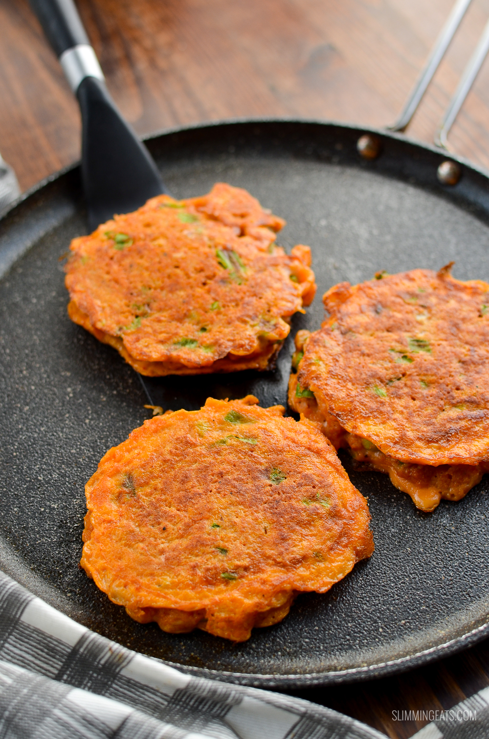 3 thai crab cakes on a skillet